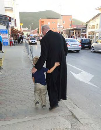 Fr. Ray with a little friend in Medjugorje